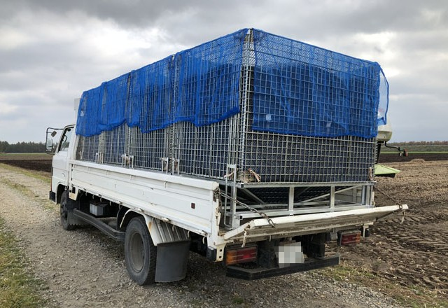 ホッパー型鉄コンテナで大豆を貯蔵庫まで輸送